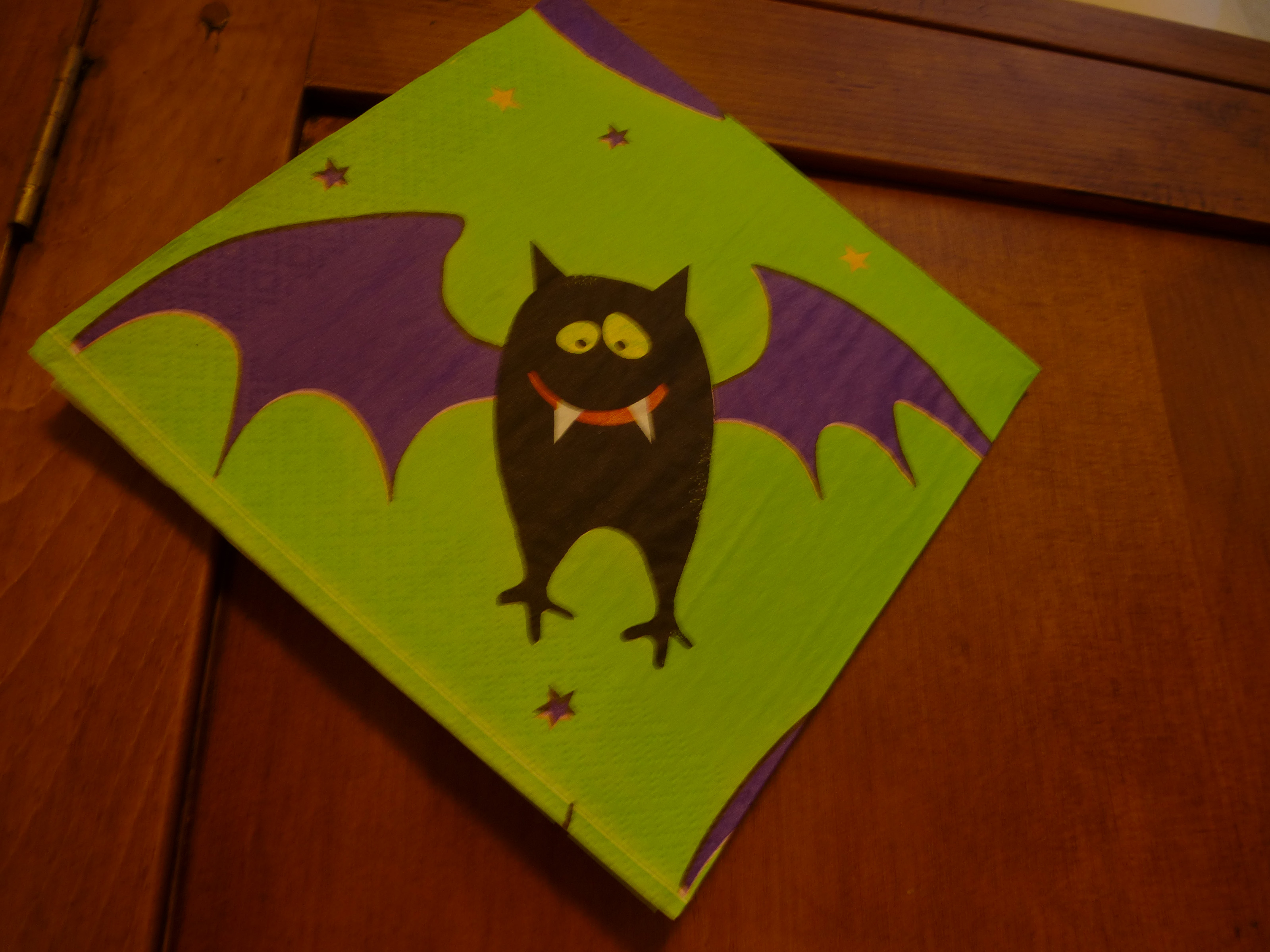 Comic Halloween bat decoration with a scary ferocious little cartoon bat with outspread wings and fangs