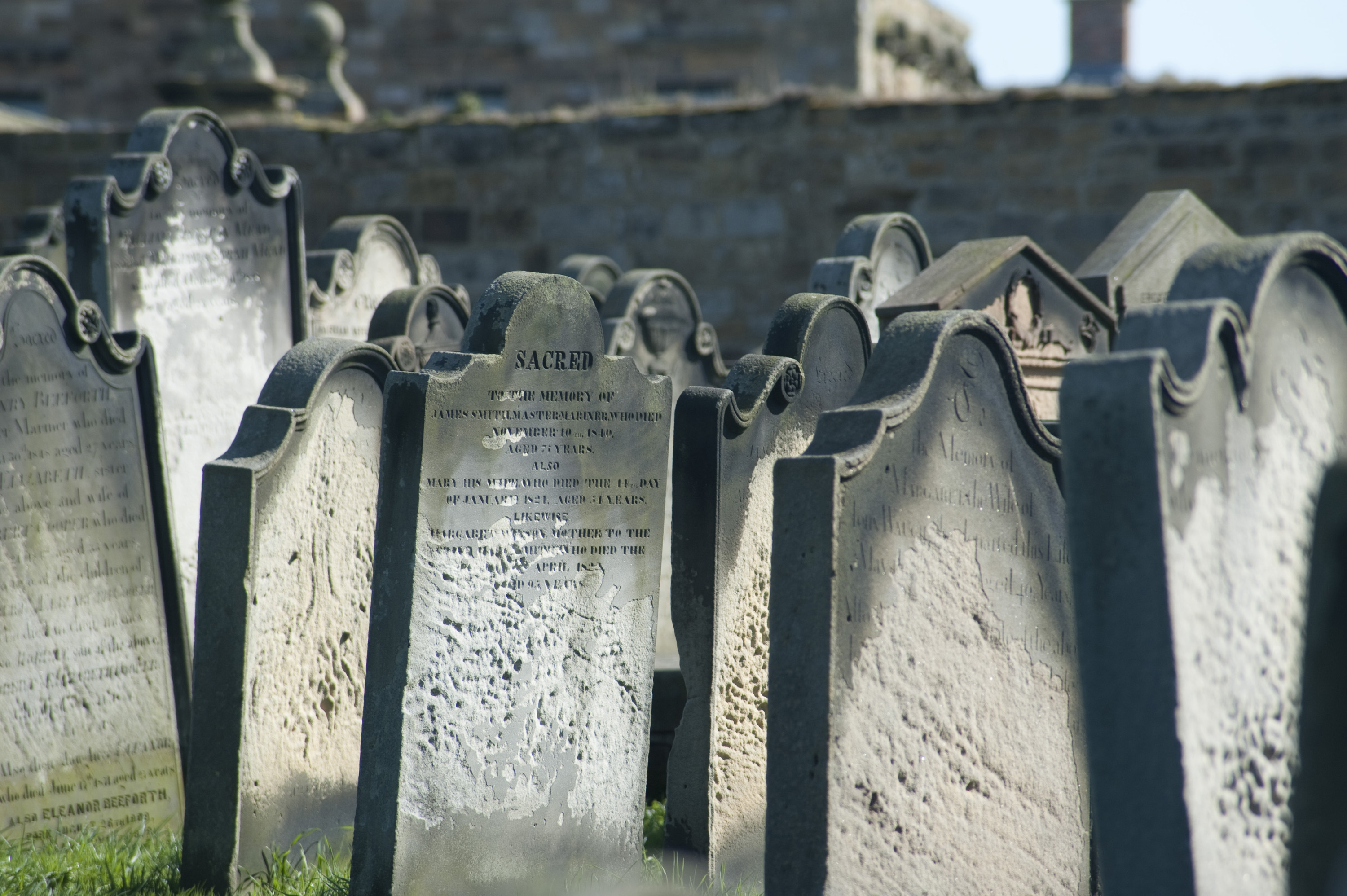 a grave yard full of historic old weathered headstones