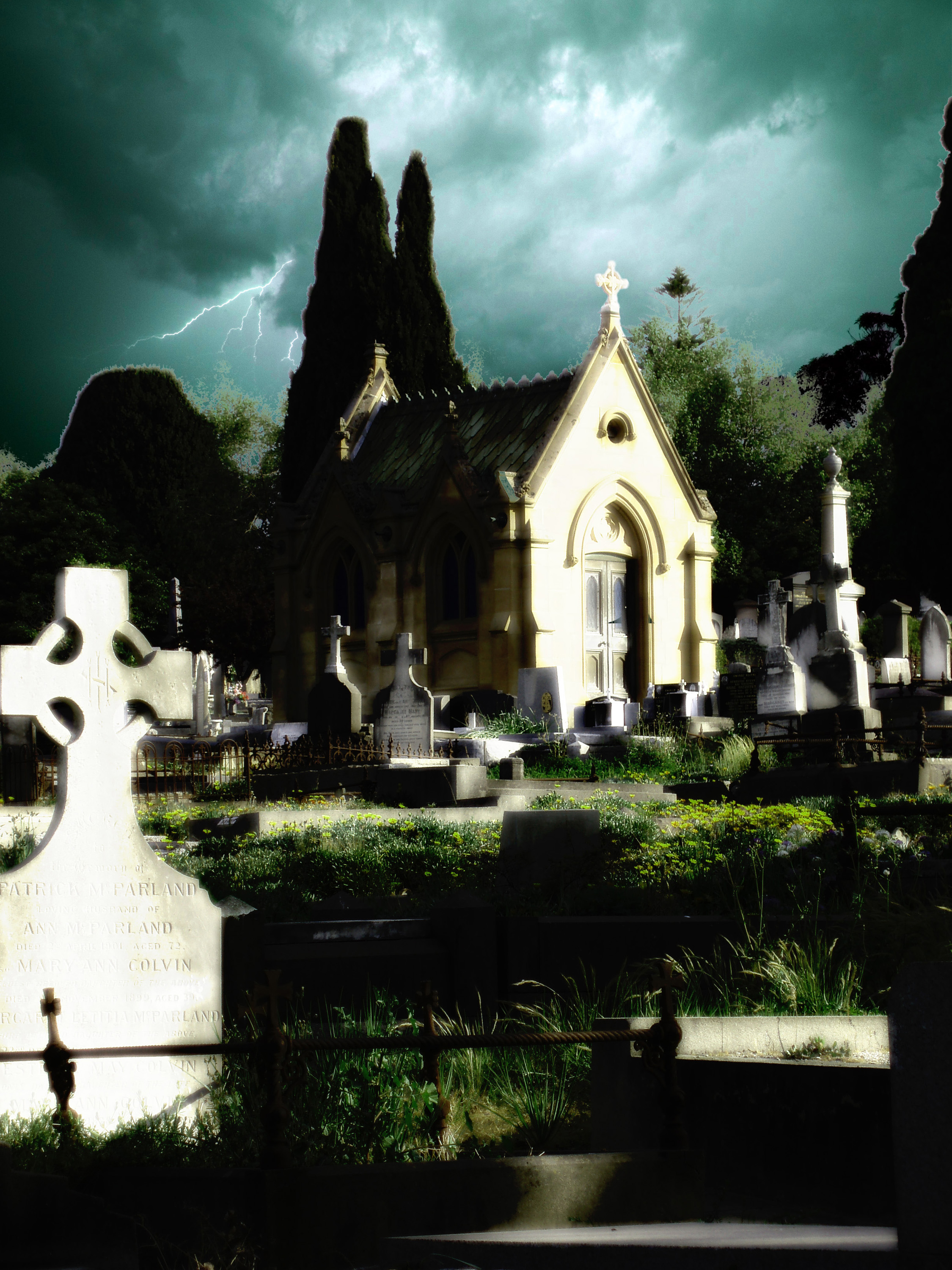 spooky cemetery scene with a tomb and lightning