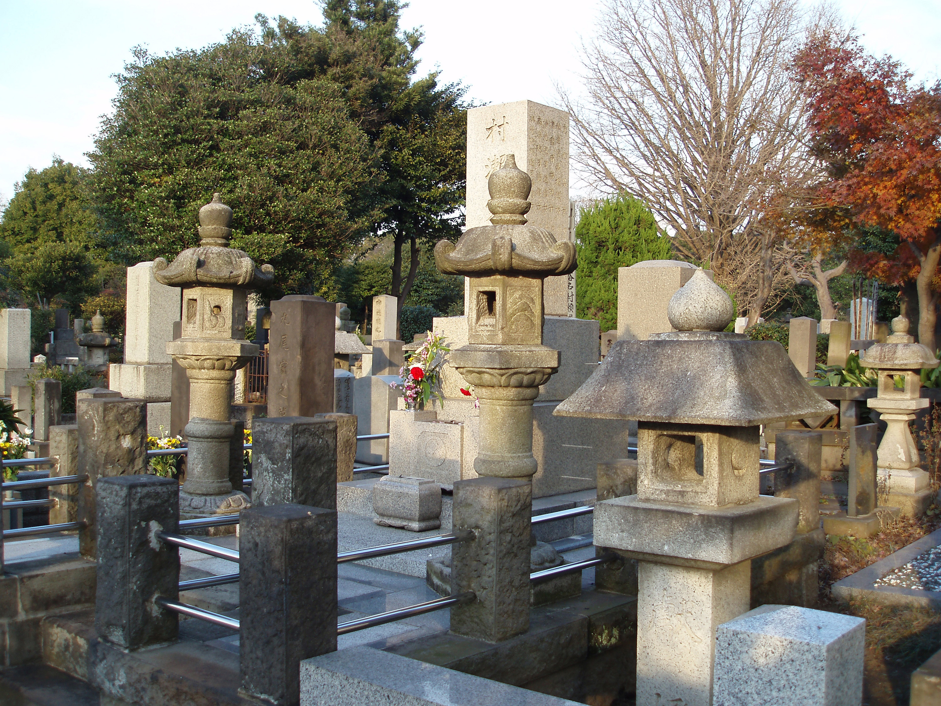 a japanese style cemetery headstones