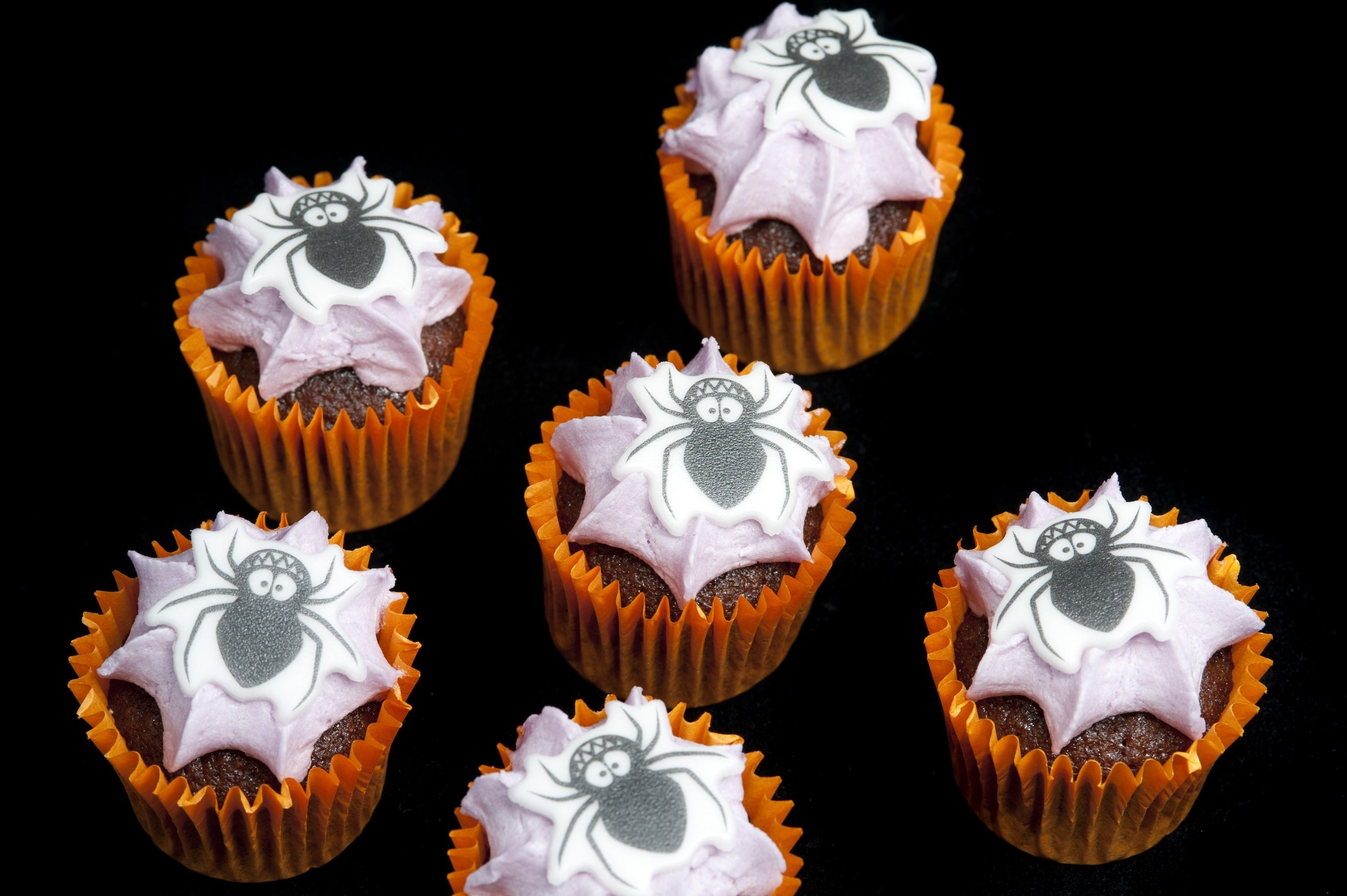 cute halloween mini cakes decorated with spider icing decorations