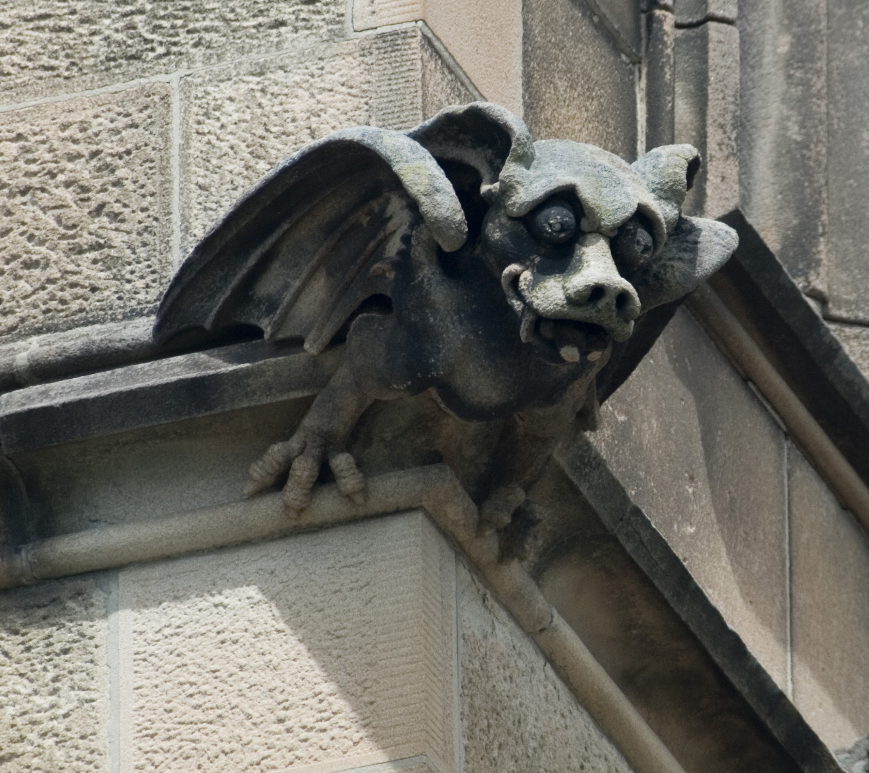 grotesque stone bat decoration