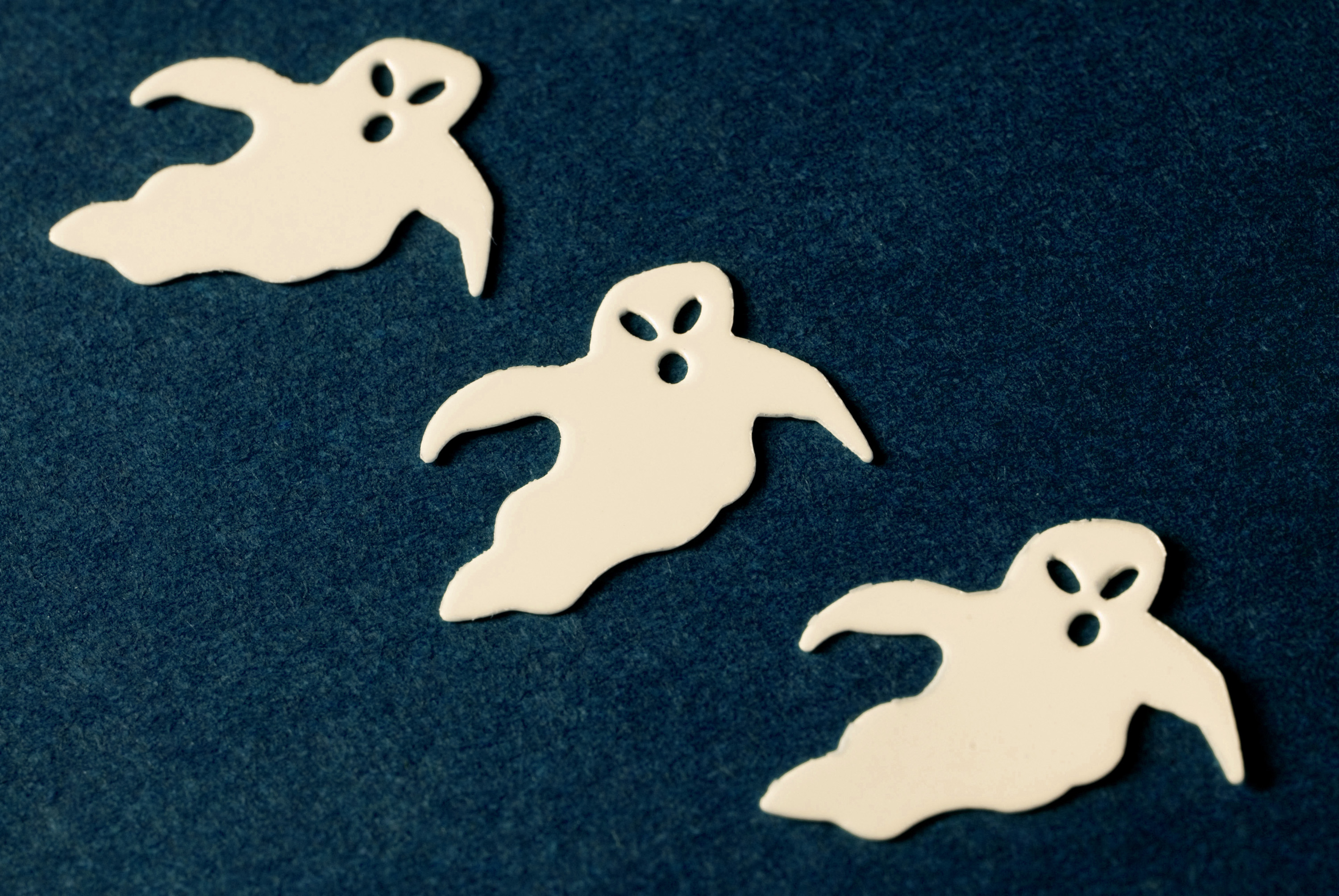 white ghost outline shapes on blue background