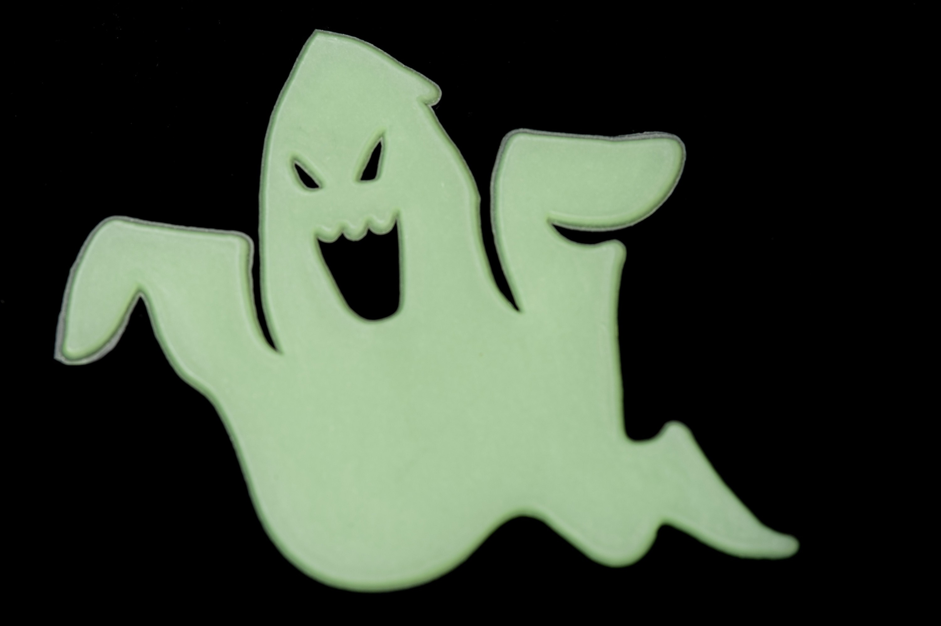 green glowing comic looking halloween ghost shaped decoration