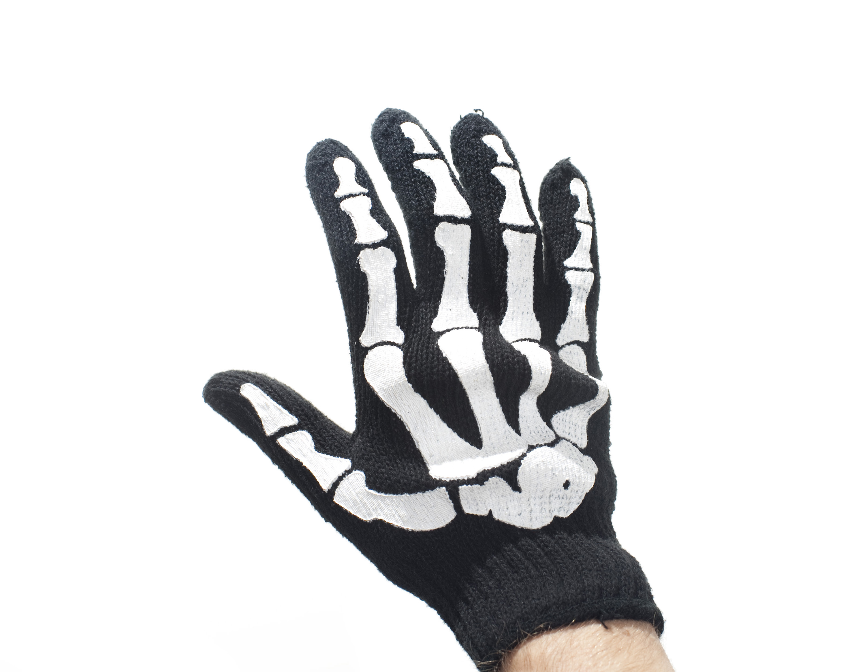 a halloween costume skeleton glove on white background