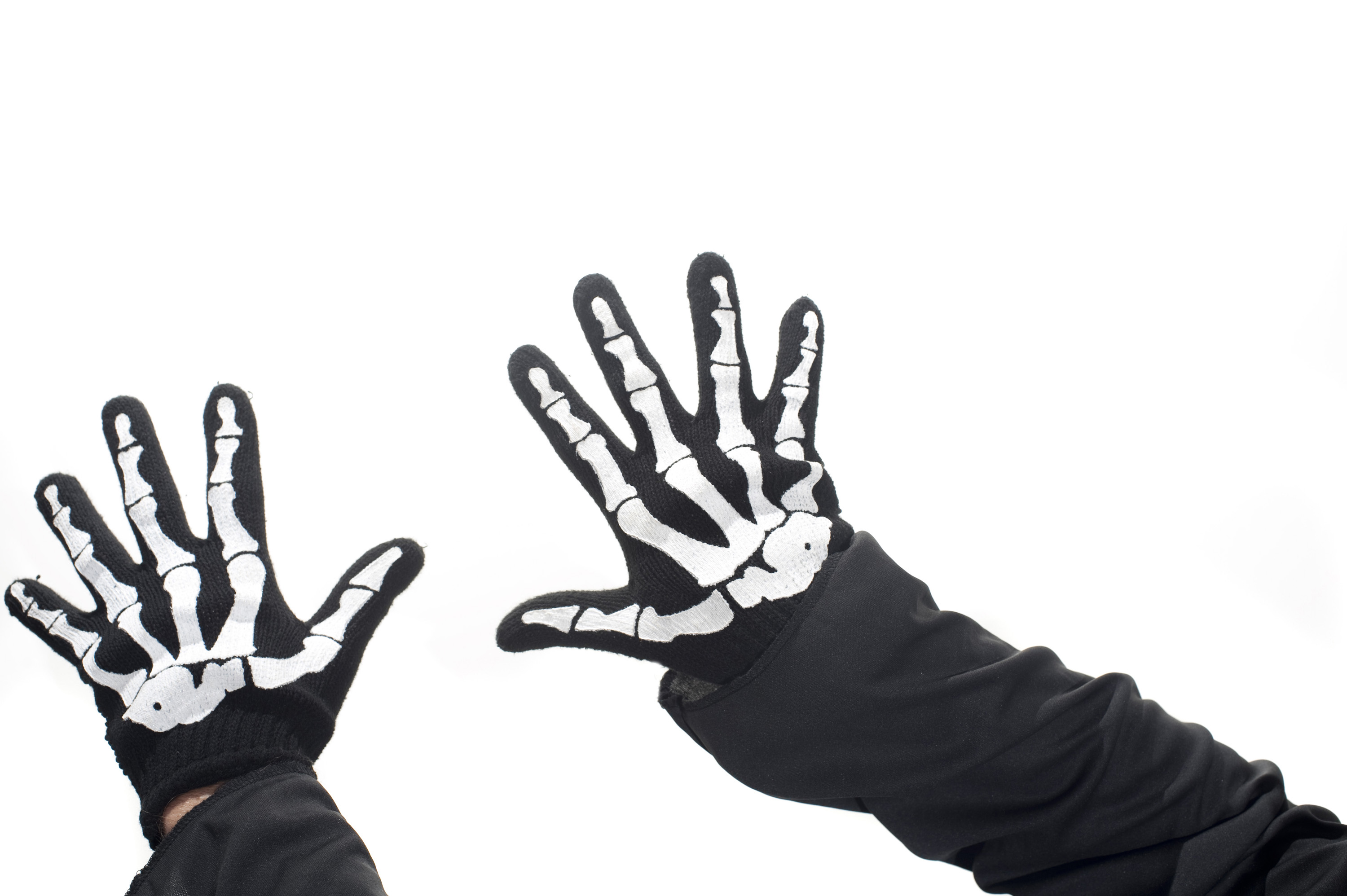 a pair of hands wearing novelty skeleton gloves
