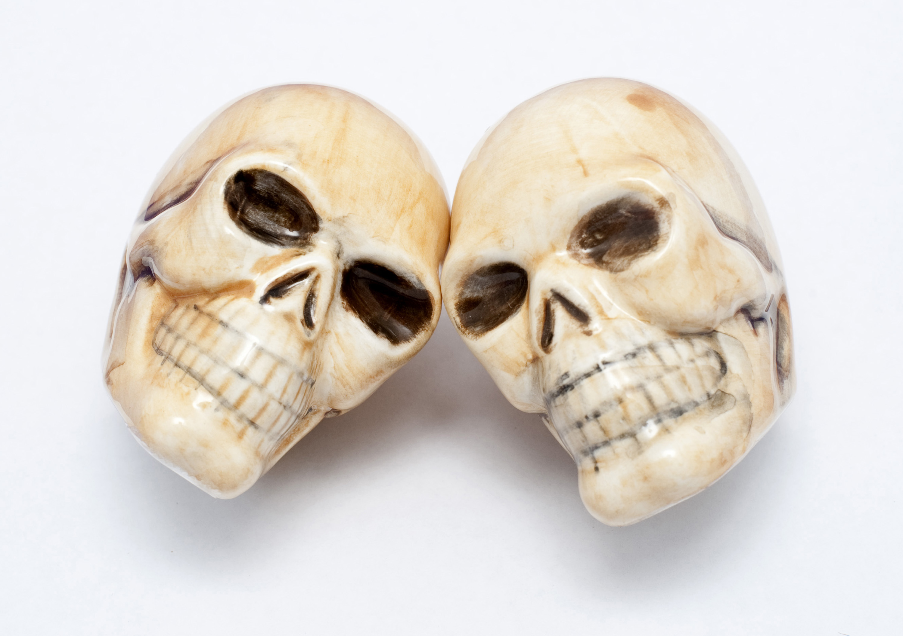 a pair of halloween ceramic skull decorations on white background - Ceramic Halloween Decorations
