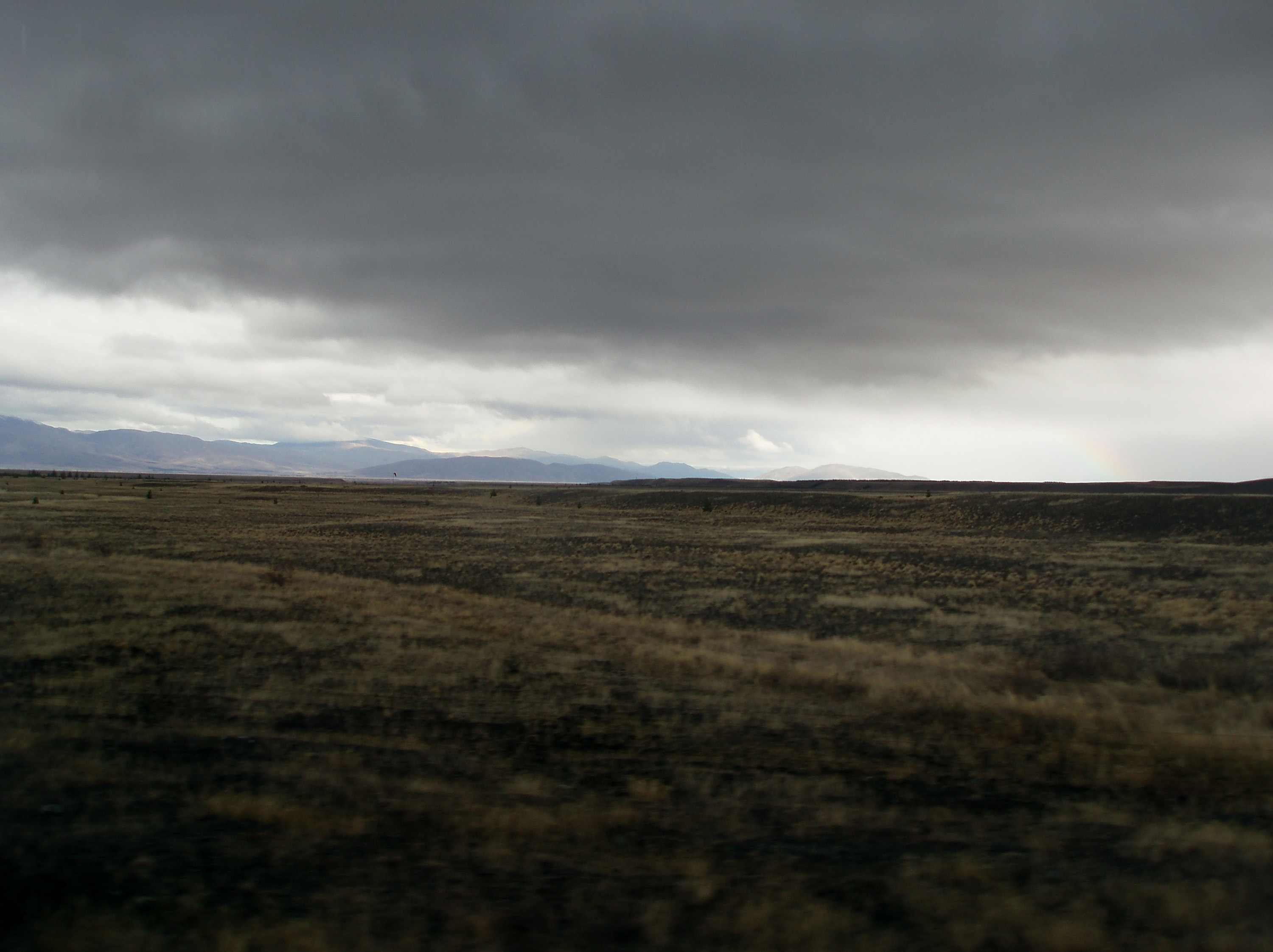 a dark foreboding landscape with low stormy clouds