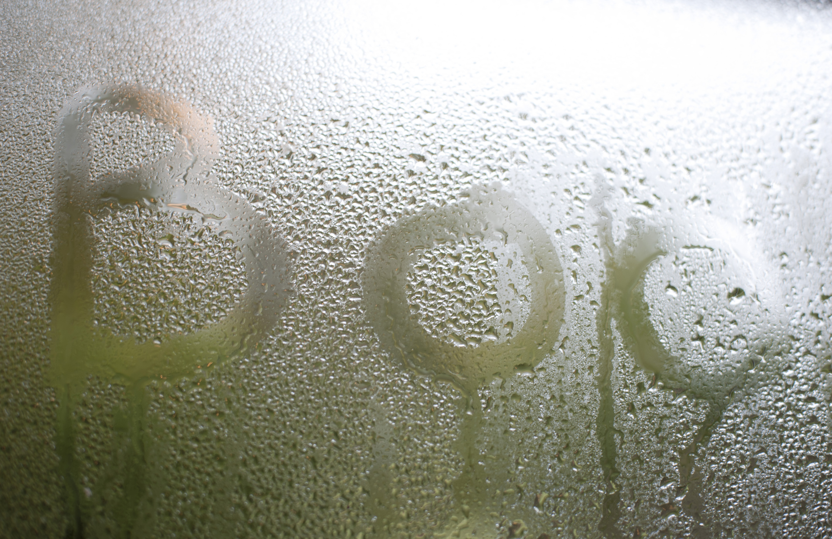 Image Of Boo Written On Condensation On A Glass Window